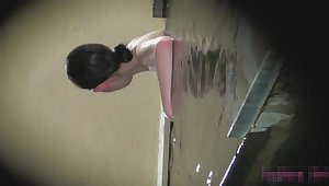 Asian girl standing in power supply and showing their tits su2664