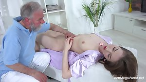 Handsome chick Roxy C spreads her hunger legs forth have sex with an old clothes-horse